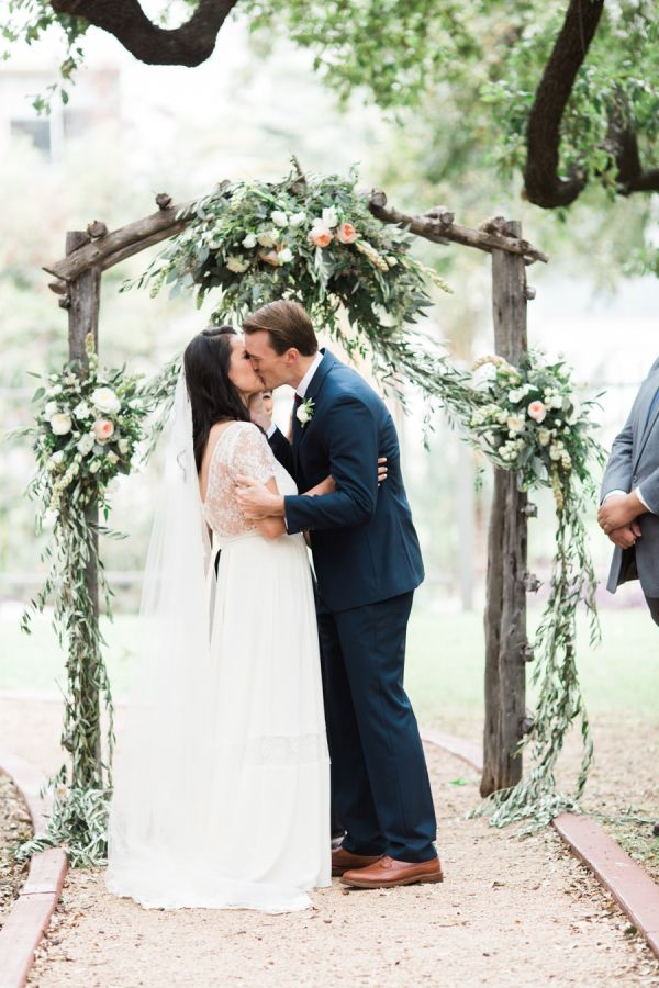Adorable post-vow kiss: http://www.stylemepretty.com/2016/04/11/wedding-with-earthy-floral-greenery/ | Photography: Loft Photography - http://www.loftphotography.com/