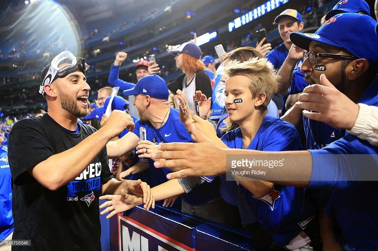 Marco Estrada #25 of the Toronto Blue Jays celebrates with fans after the Toronto Blue Jays defeated the Toronto Blue Jays 7-6 for game three of the American League Division Series at Rogers Centre on October 9, 2016 in Toronto, Canada.