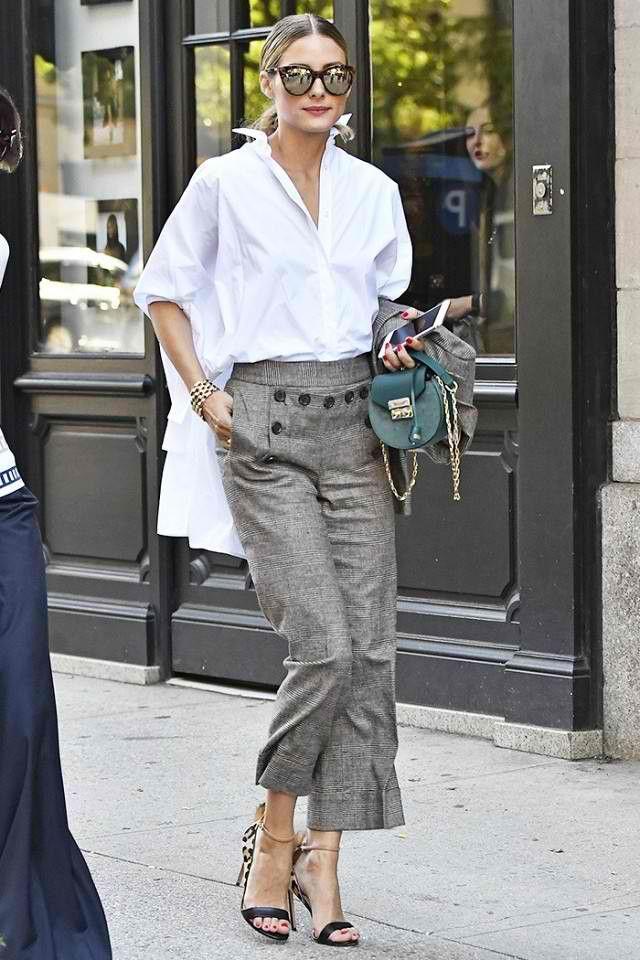 Olivia Palermo at New York Fashion Week, September 2016. Salar Milano bag + Le Specs Half Moon Magic sunglasses.