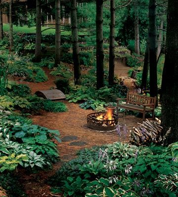 This is a gorgeous shade garden under the pines, love the bench and the firepit too. [ TheGardenFountainStore.com ]