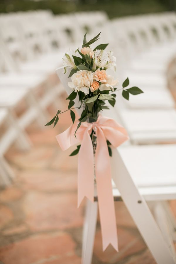 peachy pink flowers + ribbon // photo by Mustard Seed Photography // View more: http://ruffledblog.com/english-garden-inspired-wedding/