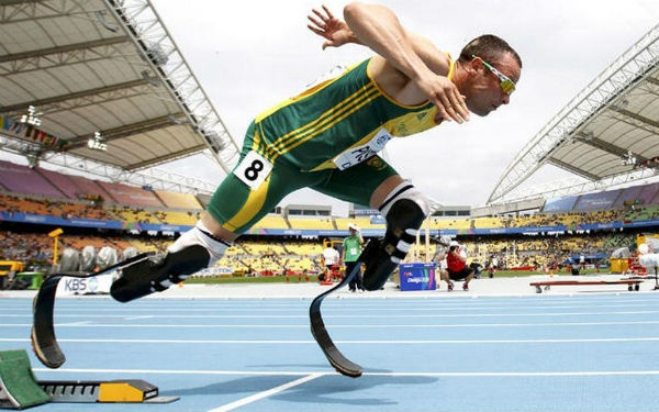 Oscar Pistorius, a member of South Africa's national track and field team, will make Olympics history as the first athlete to compete with a prosthetic limb. The sprinter will compete in the 400-meter race Saturday, using two high-performance carbon fiber artificial legs.  Inspiring.