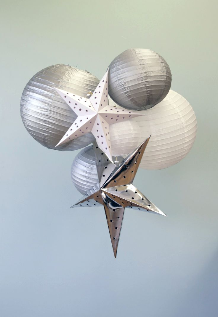 Paper lantern  and cardboard star cluster in white and silver would look stunning over the Christmas table or in a blank corner of the home to jazz things up | Aqua Silver White Christmas Decorations | The Paper Lantern