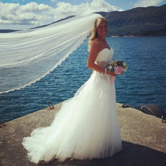 Wedding dress,veil and hair caught by the wind.