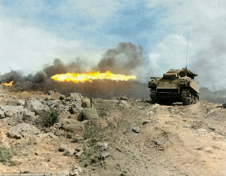 Iwo jima march 45 a Sherman tank M4A3R3 nicknamed Zippo spews flames into Japanese pillbox