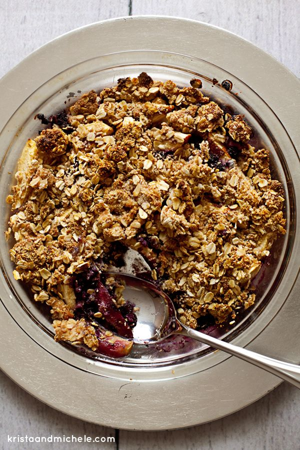 Apple Blueberry Crumble. Healthy, no refined sugars, no flour and yet still crunchy and sweet. Guilt free dessert that is healthy enough for breakfast. Recipe @ kristaandmichele.com
