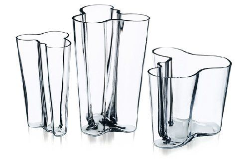 """iittala Aalto Vase - Clear - Small by Aalto. $65.00. Handblown crystal. h 3.75"""". 71 years after its introduction, Alvar Aaltos signature design remains a modern classic. An homage to his name (Aalto means wave in suomi), this undulating pattern seemingly flows in concert with the water it contains. All aalto vases and bowls are cast from lead-free crystal, which is mouth-blown into its mold and hand-polished. These various configurations are available in a selection of colors."""