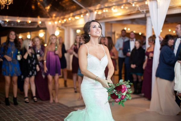 Wedding reception photo idea - bride caught in action about the throw the bouquet at the bouquet toss {Amy E Photography}