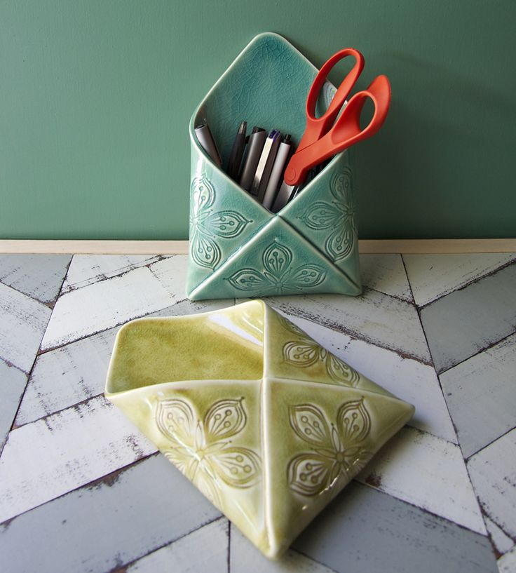 Porcelain Envelope Wall Vase | Though this nifty envelope wall vase was designed with flowers in mind (read: it can hold water), it does a great job with pens and mail too. Each porcelain vase is completely constructed by hand, stamped with a floral design and then glazed in green or blue.