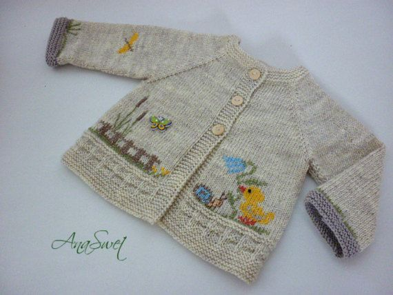 Hand knitted baby cardigan wit |