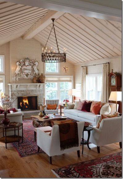 Simple furniture. Ornate accents. Color heavy on the bottom of the room,
