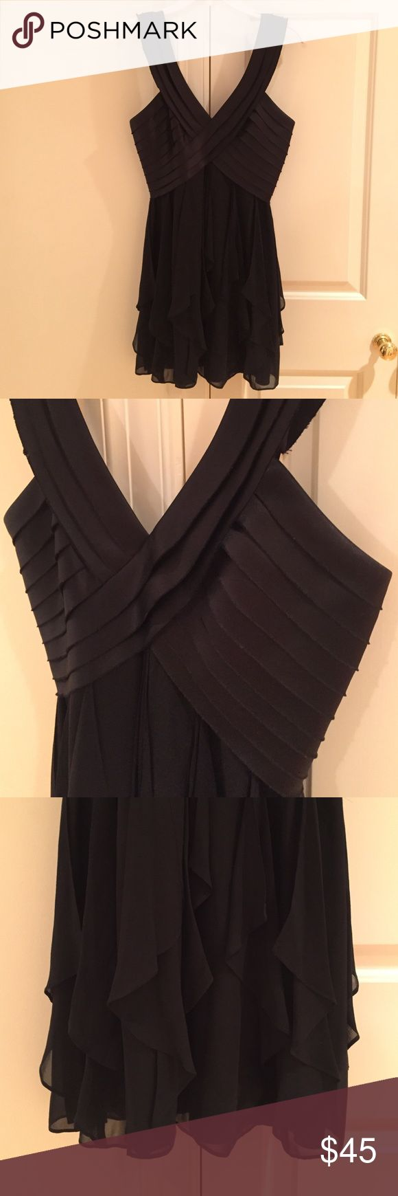 BCBG MAX AZRIA Petites Formal Dress Black formal dress with crossover top and flowy skirt. Worn once. Moves beautifully, great for formal occasions! BCBGMaxAzria Dresses Mini
