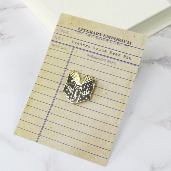 A shiny little enamel pin badge featuring a readers gonna read book design. A perfect gift for a book lover.  Adorn your denim jacket, tote bag, backpack or coat with a cute little book pin badge. A lovely literary gift for birthdays, Christmas or as a treat for yourself.  Made from durable hard enamel with a gold coloured outline, this book brooch pin comes presented on a library card and makes a fun gift for a reader. made from:  Gold toned metal and hard enamel.  dimensions:  2.5 x 2cm