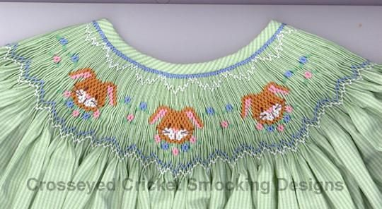 Smocking plate with bunny faces. 8 rows of smocking on a bishop.