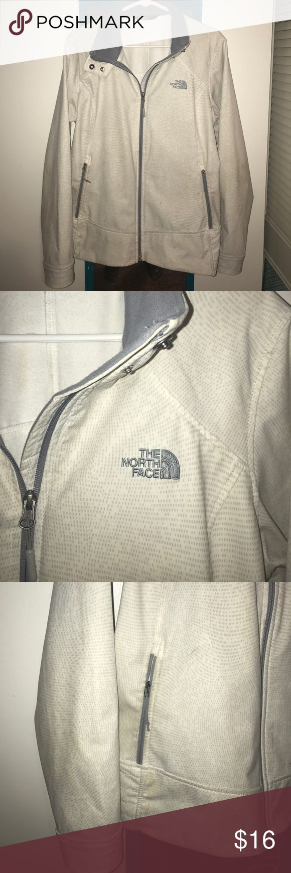 The North Face Women's Rain Jacket This rain jacket by The North Face features two front pockets and gray accents on sleeve and collar. Minor wear & price reflects! The North Face Jackets & Coats