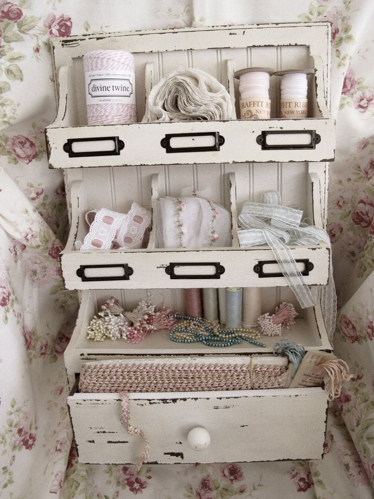 Love this little old spice rack redone as a art supply cabinet for lace & such.