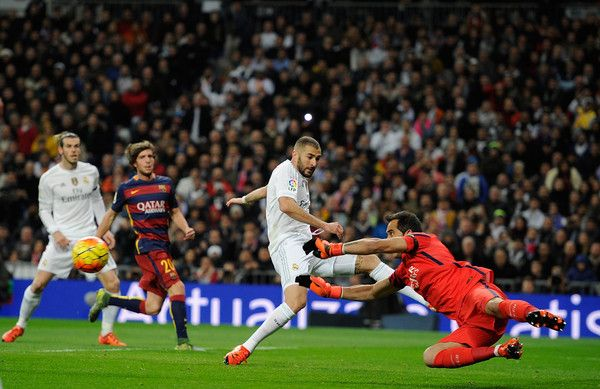 Claudio Bravo of FC Barcelona saves from Karim Benzema of Real Madrid during the La Liga match between Real Madrid and Barcelona at Estadio Santiago Bernabeu on November 21, 2015 in Madrid, Spain.