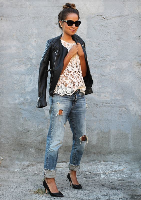 A black quilted leather moto jacket and blue distressed boyfriend jeans are your go-to outfit for lazy days. Black leather pumps will instantly smarten up even the laziest of looks.   Shop this look on Lookastic: https://lookastic.com/women/looks/black-biker-jacket-white-tank-blue-boyfriend-jeans/18596   — Black Quilted Leather Biker Jacket  — White Lace Tank  — Blue Ripped Boyfriend Jeans  — Black Leather Pumps