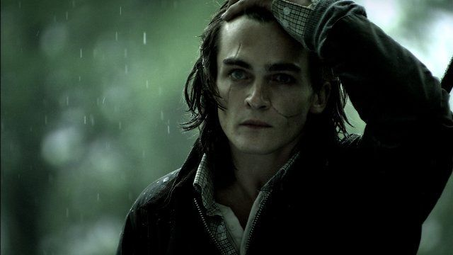 The rain had swept his hair over his forehead so that she could hardly see his face. That was solved a second later, however, when he dashed his hand through it, so it was slicked back. The boy would've been handsome too if it weren't for the two scars that marred his face. She tried not to stare at them, but it was probably obvious as her eyes kept drifting back to them