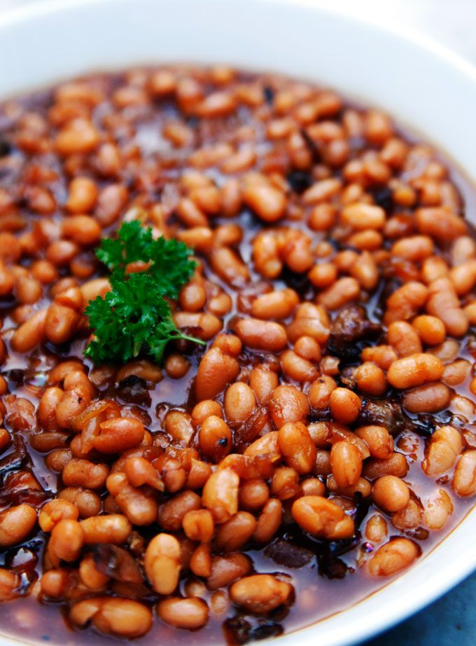 The secret to cooking really great Boston baked beans is to heat them on a low and slow setting to allow the beans to soak up its sweet, tangy and savory sauce. Baked beans are a popular American side dish often served during barbeque gatherings and summer patriotic holiday get togethers. The difference between regular baked beans and the Boston variety is the inclusion of molasses, which dates back to colonial times in New England. Get the recipe!