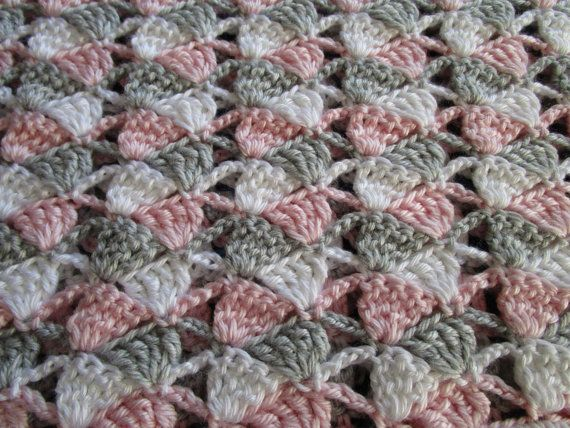 The Sideways Shell Stitch Crochet Blanket is an easy pattern that produces impressive results. The pattern is suitable for a girl or boy. This