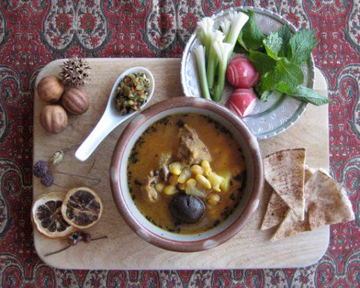 Abgoosht (abghust) Persian lamb soup with chickpeas beans dried limes and garnished with fried dried mint - served with sabzi khordan (fresh herbs platter) and bread and torshi (Persian pickles) | by Fig & Quince (Iranian food culture blog)