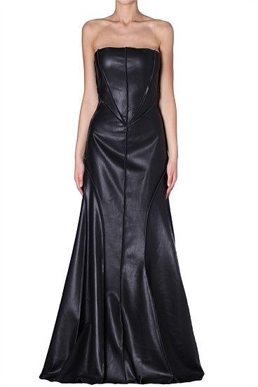 BLACK FAUX LEATHER NIGHTSHADE DRESS Dare to elevate your wardrobe with this luxe faux leather dress that offers feminine edge. Wear with hair sleek and a bold lip to create a delicate balance.