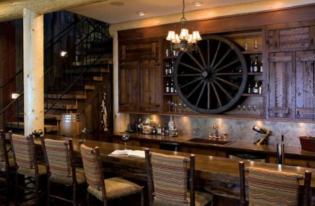 A rustic wine cellar and basement bar with rich colors and textures designed by lorrie scofield - Rustic bar ideas for basement ...