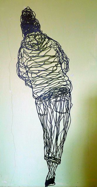 Balancing her way through life | paper cut by Kris Trappeniers
