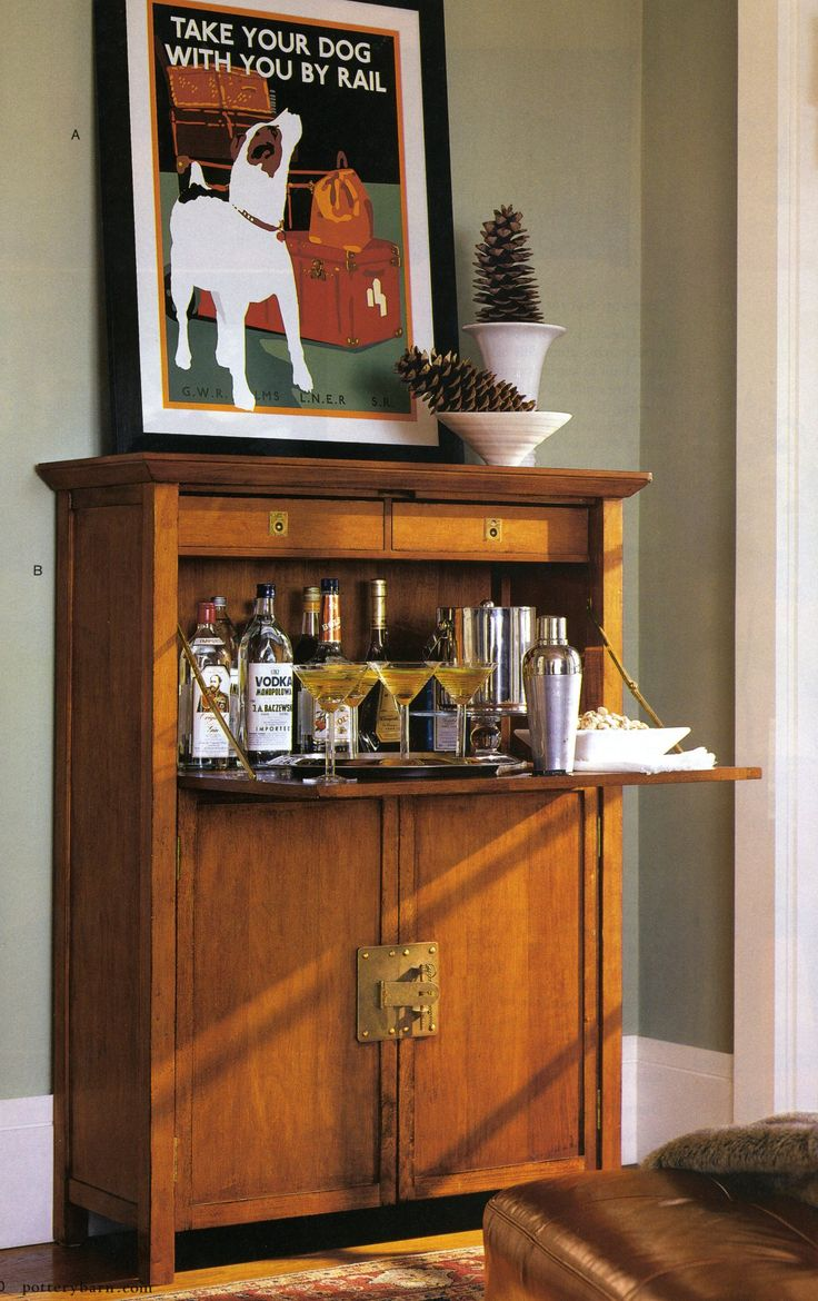 Liquor cabinet in a secretary desk.