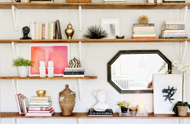 I did these exact shelves (wood stain in all) in a studio project. LOVE these Ikea brackets.
