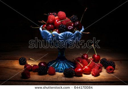berries inside blue glass bowl