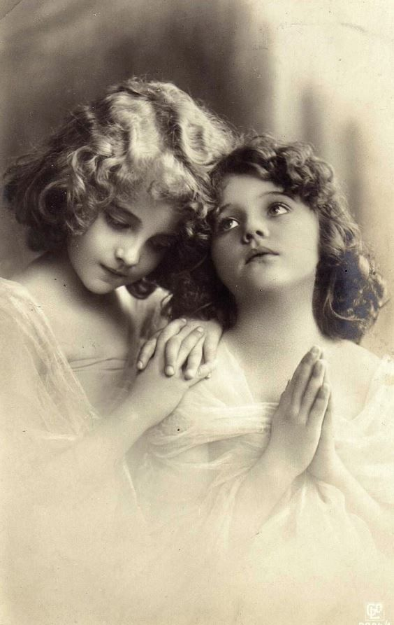 Victorian girls sisters praying vintage Christmas real photo postcard with the Reinwald sisters, Grete and Hanni.