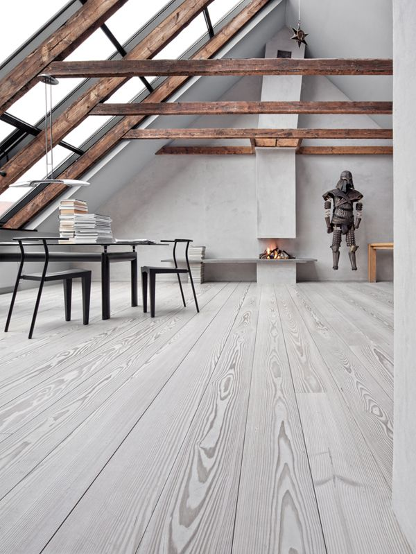 = soft grey floorboards - OK so I love the floorboards but this is minimalism gone mad; a mile of empty space, a ludicrously small fire and that home essential a suit of armour....