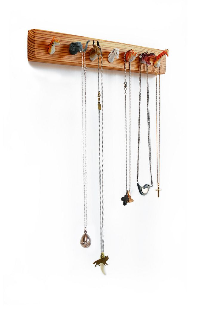 for the kid's room! Little toy animal heads (or bottoms) as hooks. #recycled #repurposed #kids