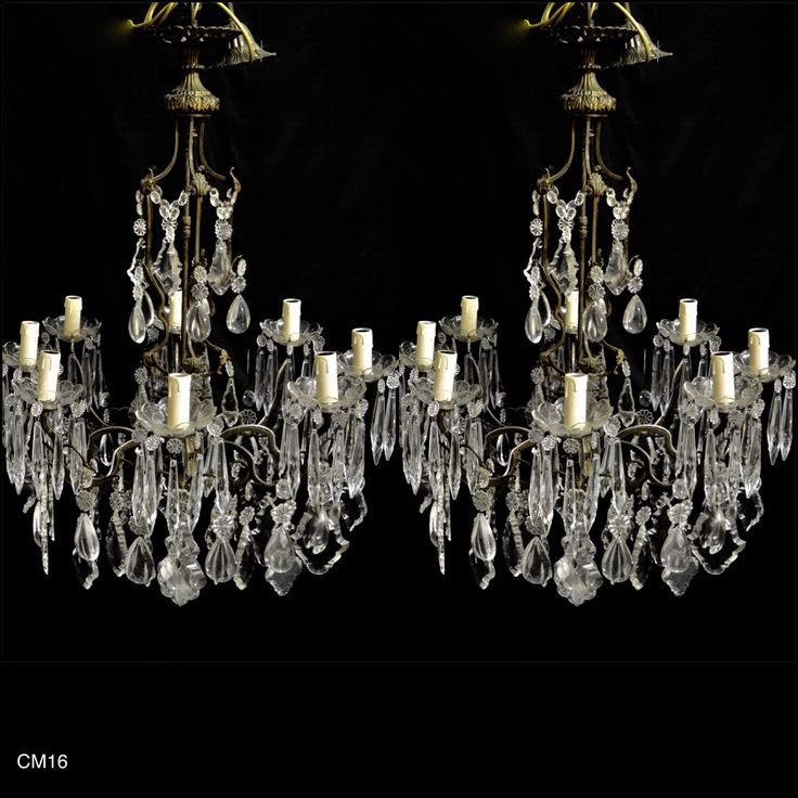 This unique and beautiful pair of Italian chandelier have 8 lights per chandelier. The dark brass frame closes in a shape of a bird cage where 8 scrolling arms sustain 8 cut glass cups where a 12 cm icicle cut crystal drops hang all over. Oval bottom chains on the top of the chandelier support French cut crystal drops. More French cut crystal drops and smoot pear drop crystals are hanging all over the bottom of the chandelier supported by flower shape crystal bottoms