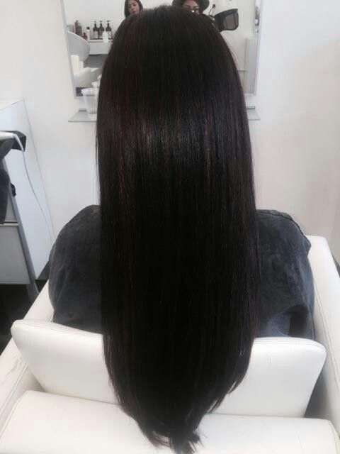 Dark brown hair Brazilian blow out with magenta highlights