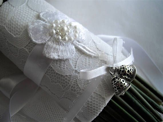 Irish Tradition White Shamrock/Wedding Bells Bouquet Wrap.  Comes to you ready to gift in a clear box with my handmade tag included and the History of the Irish wedding bells card, this card may serve as a congratulatory card. Shipped in 1 business day mailed priority mail delivered in 1-3 business days in the Continental U.S.  At weddings in Ireland the guests were given a small bell said to ward off evil wishes. Not comparable to the church bells but the same meaning: The ringing of a ...
