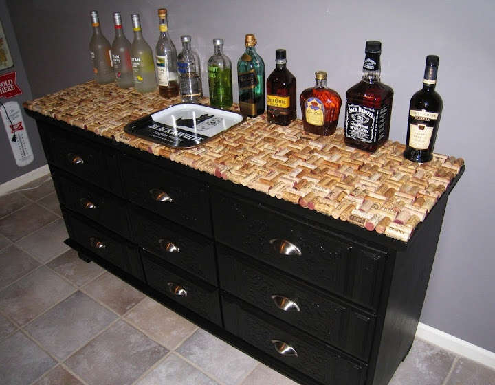 up-cycled wine-cork bar table--half wine cork, other half beer bottle tops
