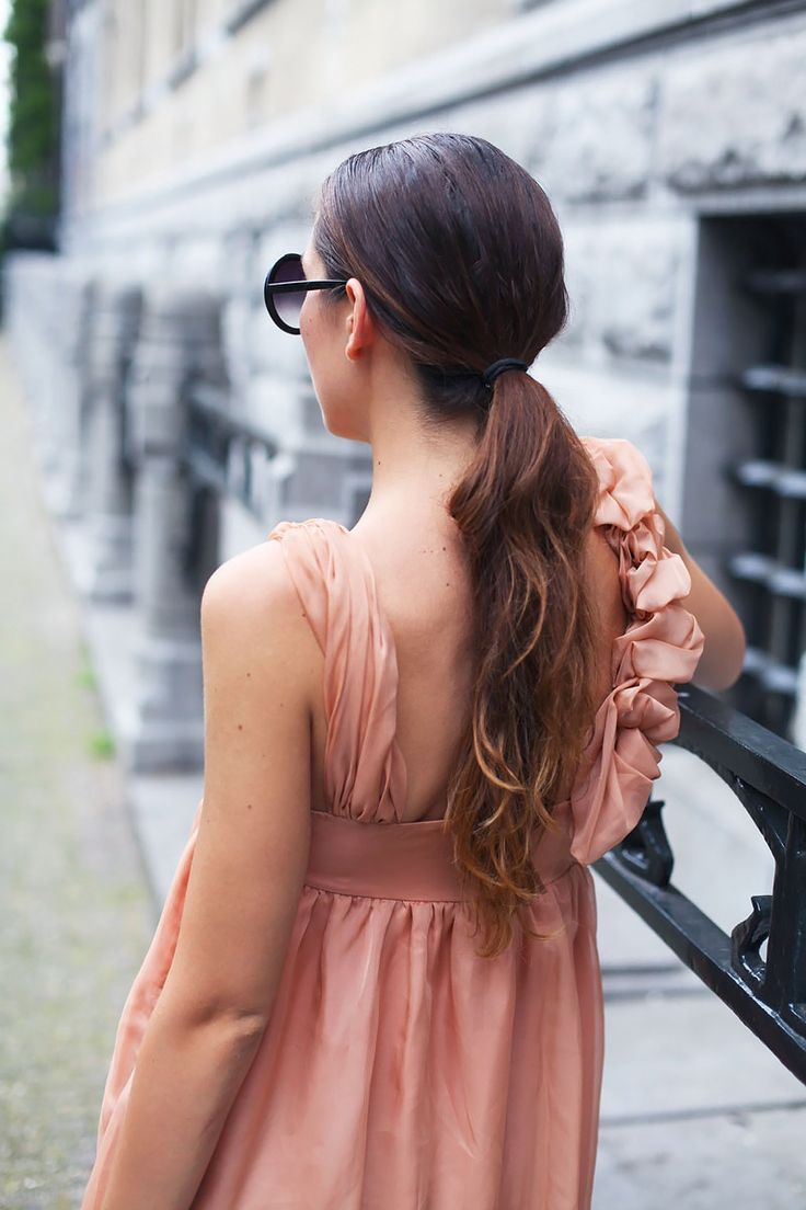 A low ponytail is a super chic way of styling your hair for daytime to keep it off your face. For evening, add some bright lipstick and big earrings to transform your hairstyle!