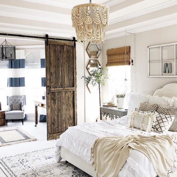 You have to see this #farmhouse bedroom decor idea with a beaded chandelier. Love it! #BedroomIdeas #HomeDecorIdeas @istandarddesign