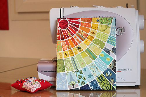 made from a cotton artist canvas, quilting fabric, with some acrylic paint and sand paste for texture.