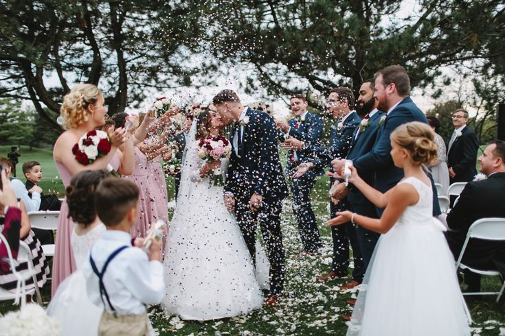 Wedding Photography in Windsor Ontario - Bride and Groom Kissing under the Colourful Confetti- Curescu Photography