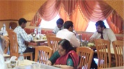 Saravana Bhavan, amazing vegetarian restaurant in the middle of Chennai. Try the mint chutney. Full of locals. Was there 26 Jan 2013.