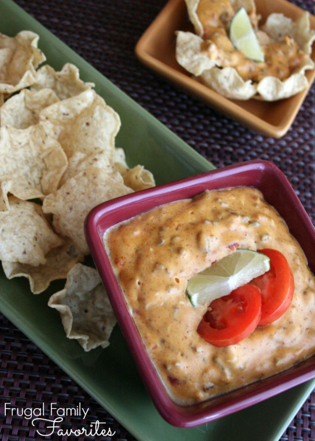 An amazingly-easy hot taco dip recipe that you can just toss in the slow cooker and serve in a couple of hours. Now who is the hostess with the mostess? You are!