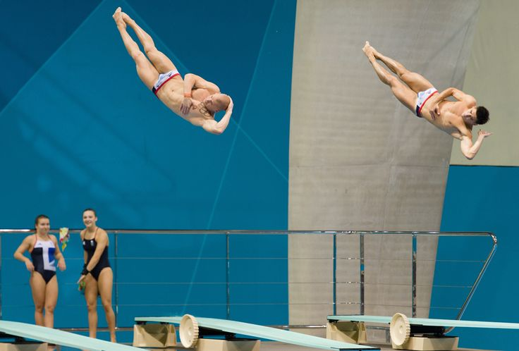 Britain's Nick Robinson-Baker (left) and Chris Mears practice their synchronized diving during a training session at the Aquatics Center in the Olympic Park in east London on July 16. (Leon Neal/AFP/Getty Images)