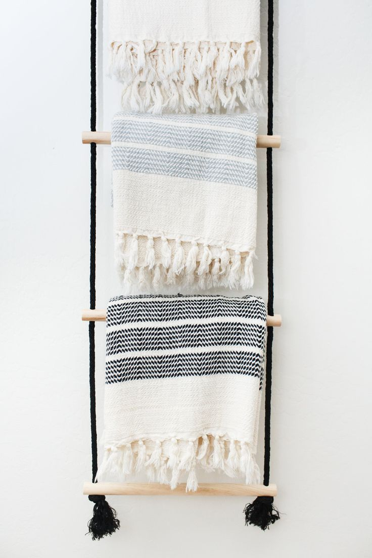 DIY hanging rope ladder as a towel rack