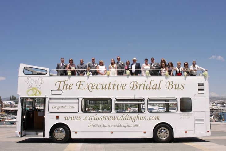 The whole wedding party poses on the open white bus :) Paphos wedding photographer. Cyprus wedding photographer. Cyprus wedding. Paphos wedding. Exclusive Bridal Bus.