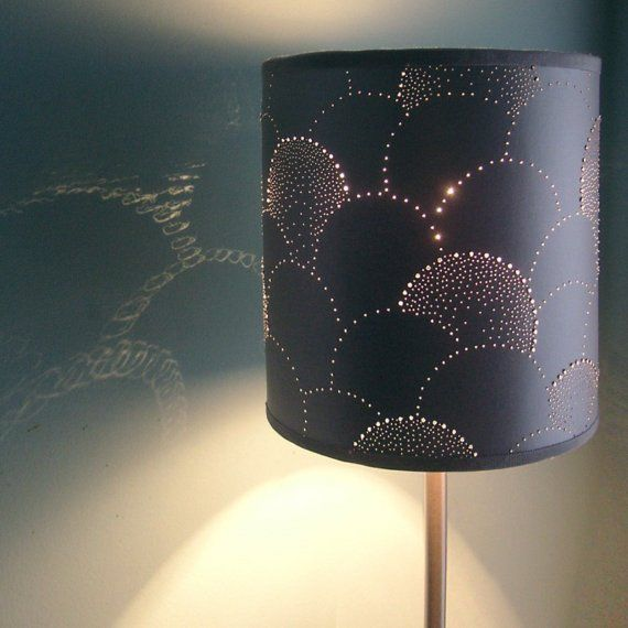 Pin-punctured lampshade with some of the holes augmented by crystals/plastic rhinestones (no tutorial but should be easy to do without one - just need to pick a pattern to make)