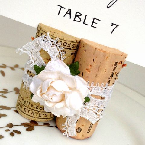 Vintage style lace & wine corks fashion a lovely Place Card Holder, perfect for romantic, rustic winery wedding or vineyard bridal shower!  For details & to buy: http://www.karasvineyardweddingshop.com/collections/classic-place-card-holders/products/vintage-lace-place-card-holder